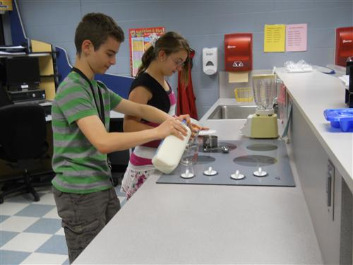 Students working at the Snack Nutrition module